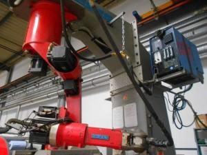 Роботизированная ячейка для сварки ковшов на базе робота REIS