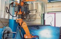 Роботизированная ячейка для сварки ковшей строительной техники в Австрии
