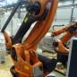Роботизированный комплекс паллетирования и упаковки емкостей, бочек на базе робота KUKA KR 100-2 PA